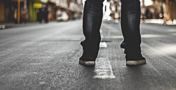 Man standing in street -1